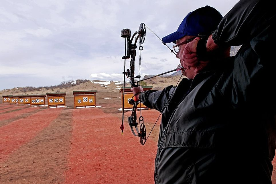 Man shoots with a bow