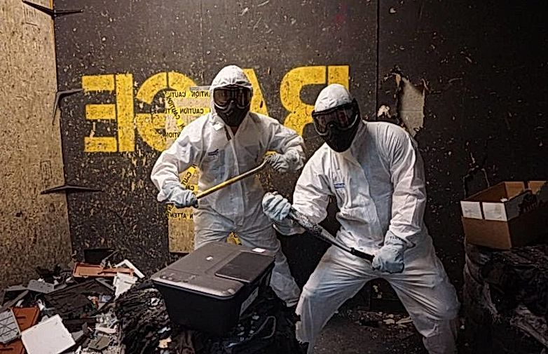Two people in a rage room